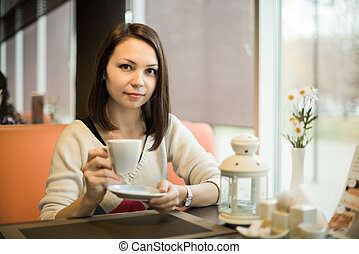 young woman in Cafe
