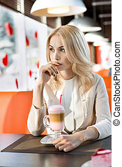 young woman in Cafe - Very beautiful sad young woman, sit in...