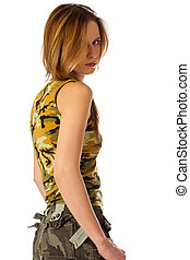 Young woman in camouflage looking over shoulder