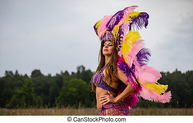 Young woman in carnival costume outdoors