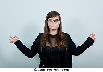 Young woman in casual clothes hold hands in yoga gesture, relax meditating