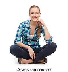 young woman in casual clothes sitting on floor