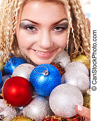 Young woman in christmas balls.