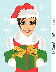 young woman in christmas santa hat holding gift box