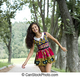 Young woman in color dress