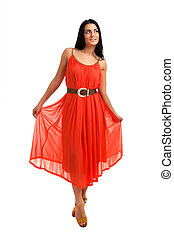 Young woman in coral dress