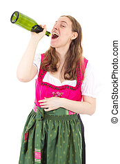 Young woman in dirndl drinking some bottles of wine