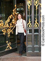Young woman in door