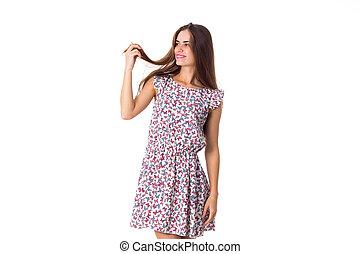 Young woman in dress touching hair