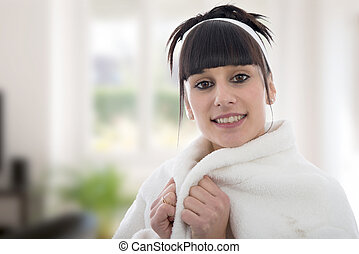 Young woman in dressing gown