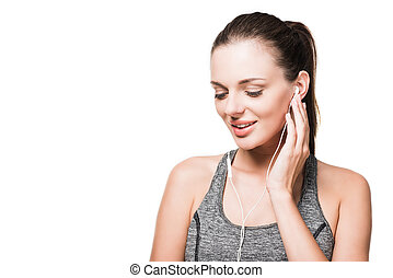young woman in earphones