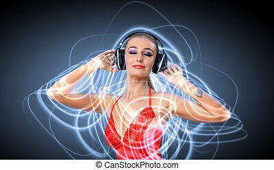 Young woman in evening dress with headphones - Portrait of...