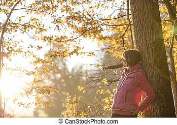 Young woman in fall woodland