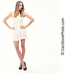 young woman in fawn mini dress on white background