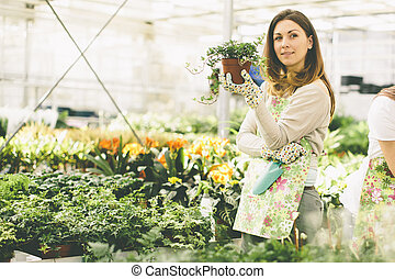 Young woman in flower garden