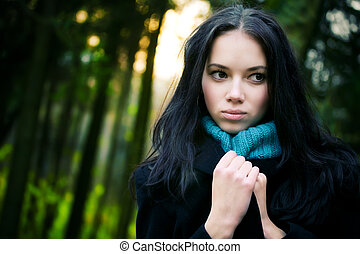 Young woman in forest. Mysterious portrait.