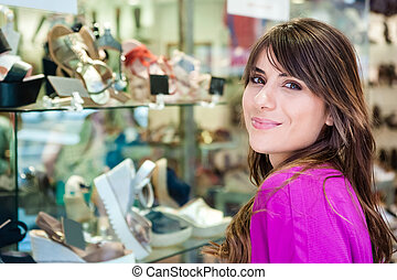 woman in front a shoes shop