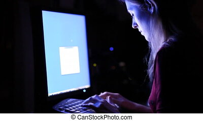 Young woman in front of computer