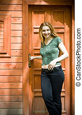 Young woman in front of her new vacation house