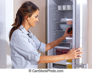 woman in front of the fridge