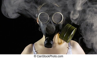 Young woman in gas mask