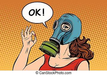 Young woman in gas mask okay gesture pop art retro vector....