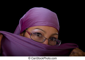 young woman in glasses with a veil, close up portrait,...