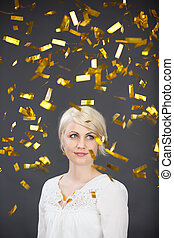 Young Woman In Golden Rain - Pensive young blond woman in...