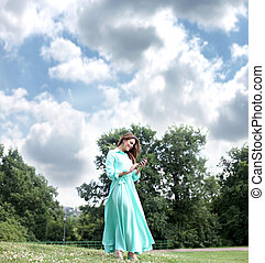 Young woman in green dress