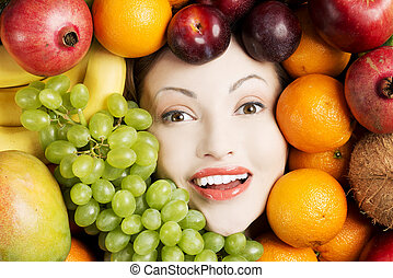 Young woman in group of fruit.