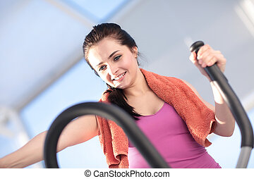 Young woman in gym doing exercises