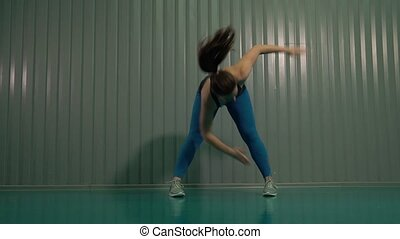 Woman In Gymnastic Suit Doing Exercises