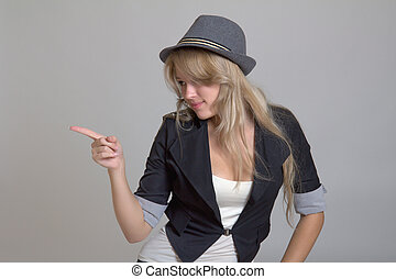 Young woman in hat pointing