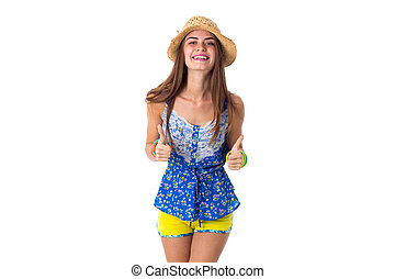 Young woman in hat showing thumbs up