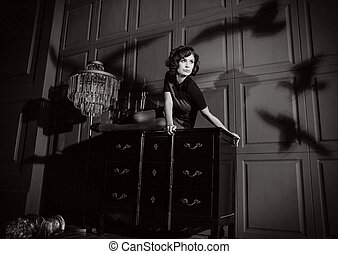 Young woman in horror movie at black and white