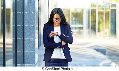 Young woman in hurry late for work. Pretty business girl or...