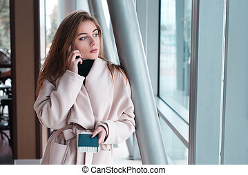 Young woman in international airport.