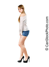 Young woman in jeans shorts - Young woman wearing blue jeans...
