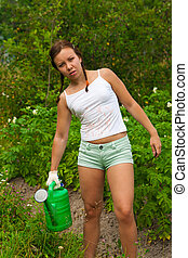 Young woman in kitchen-garden