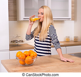 Young woman in kitchen