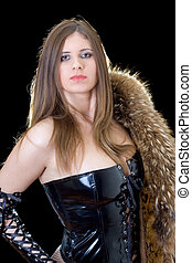 Young woman in latex suit with a fur coat