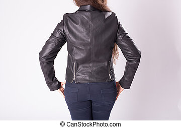 Young woman in leather jacket rear view on back