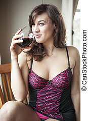 Young Woman in Lingerie Drinking Red Wine - Beautiful young...