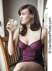 Young Woman in Lingerie Drinking Scotch - Beautiful young...