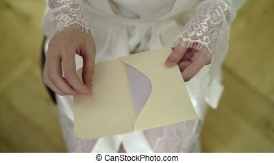 Young woman in lingerie opening mail envelope - Young...