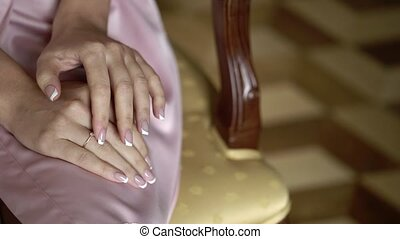 Young woman in lingerie put on ring on a finger