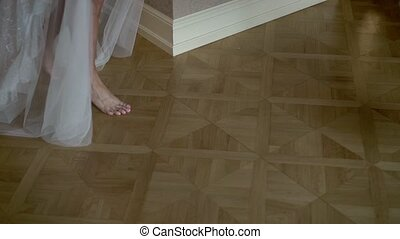 Young woman in lingerie walking in room barefoot - Young...