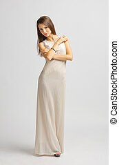 Young woman in long dress