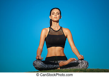 young woman in lotus position