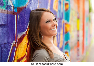 young woman in love leaning on wall and looking up. Copy...